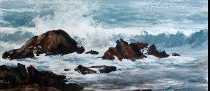 Waves crash onto rocks